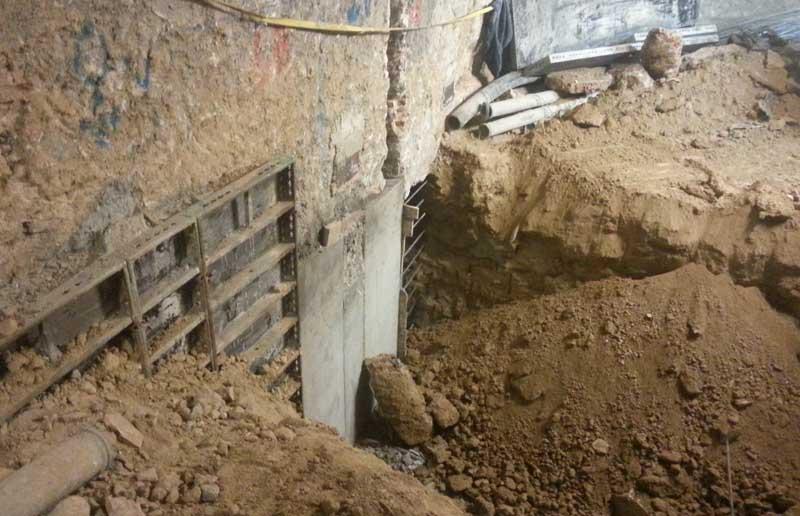 Recalce de muro de sótano por bataches